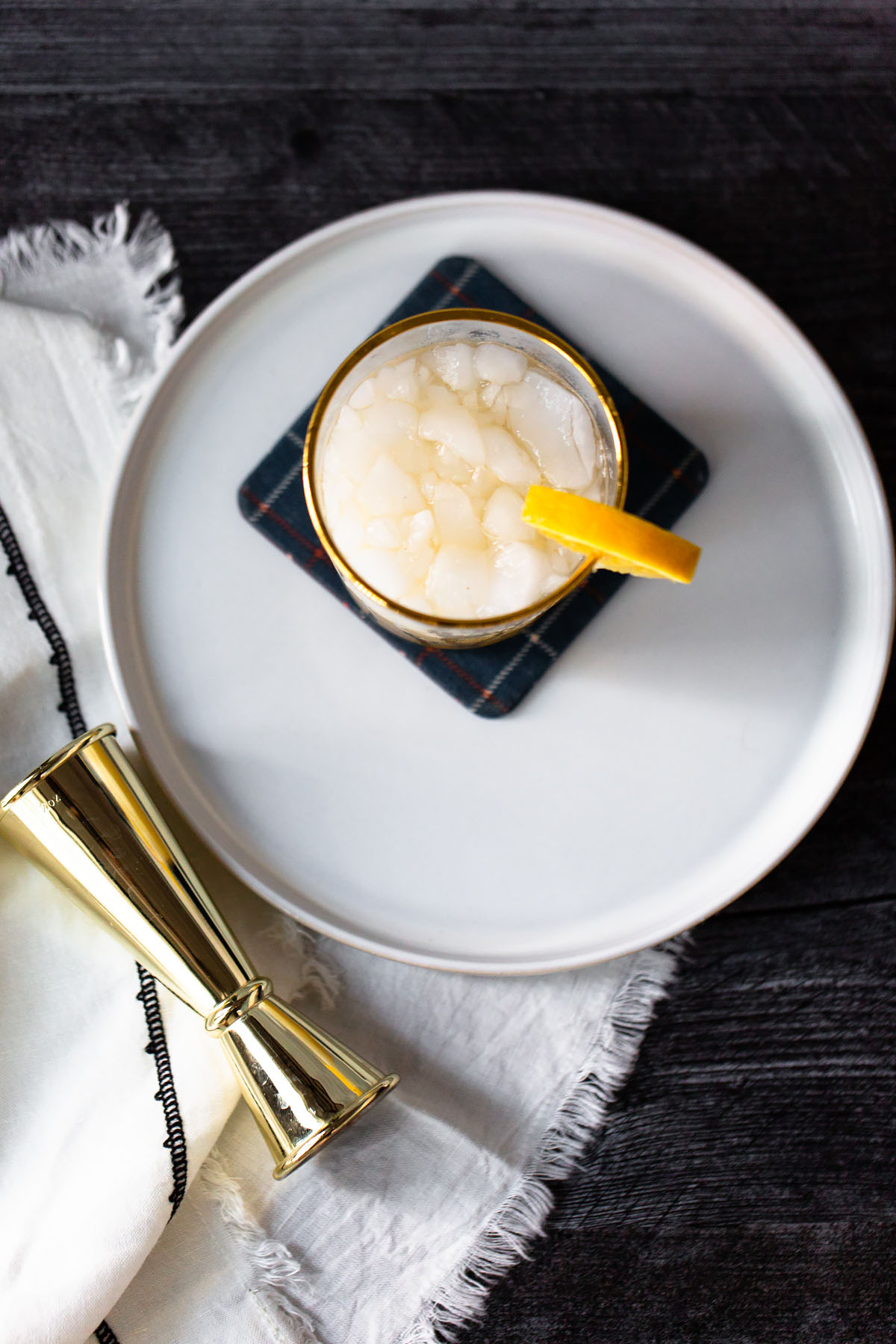fall mocktail with an orange wedge