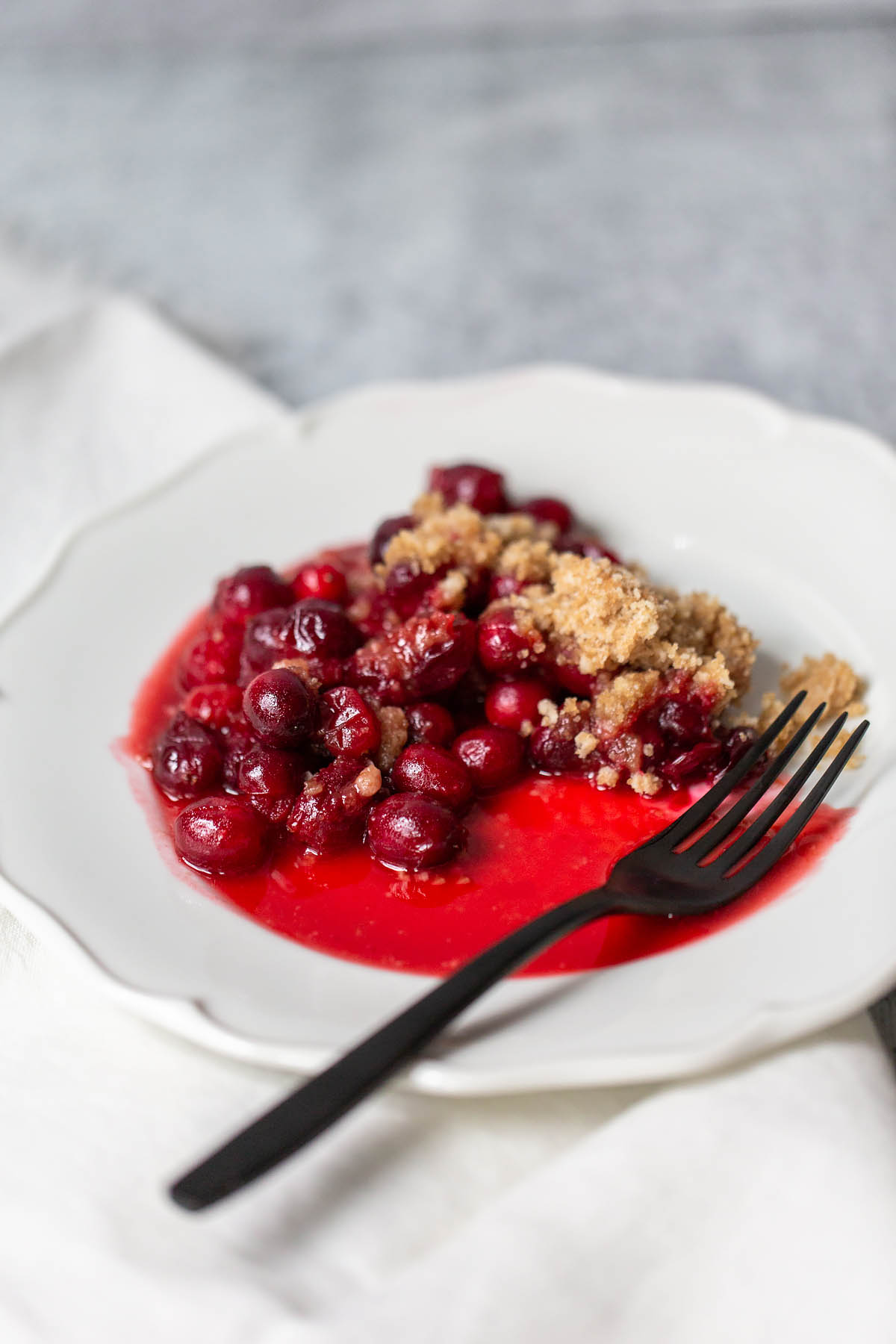 cranberry crumble on a plate with a fork