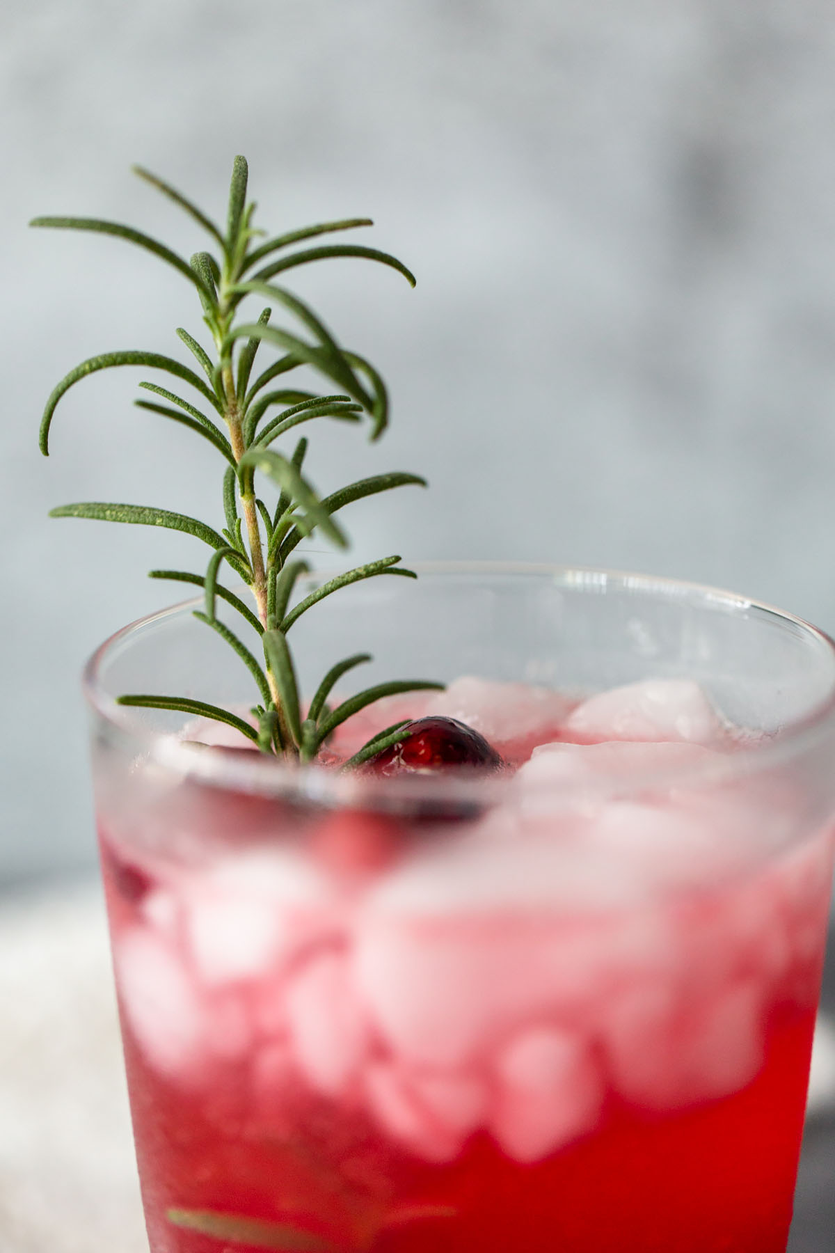 cranberry mocktail up close with rosemary
