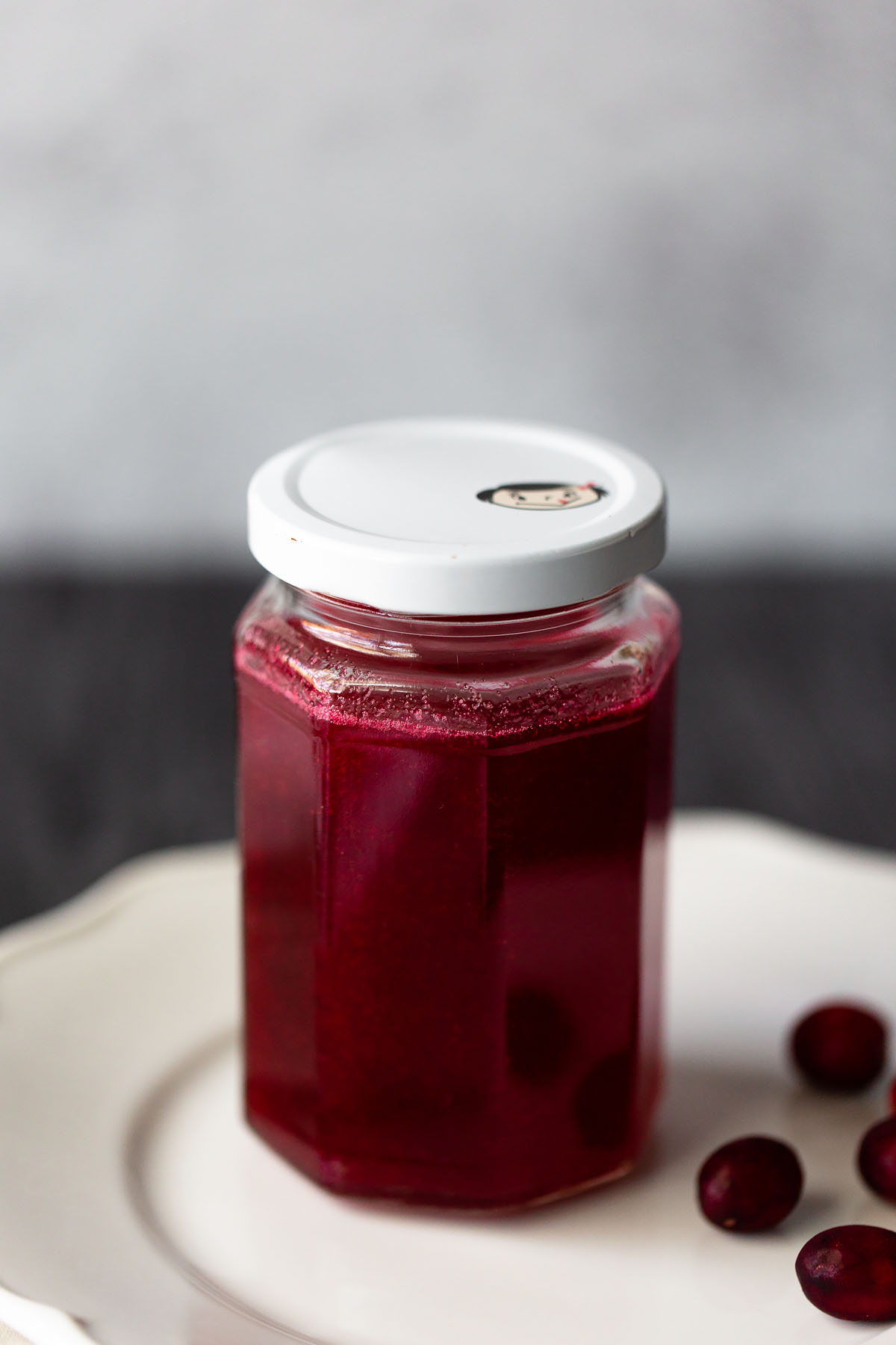 cranberry simple syrup up close in a jar