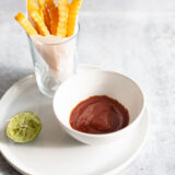 cumin lime ketchup in a bowl with fries