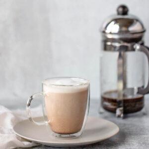 french press latte in a glass mug