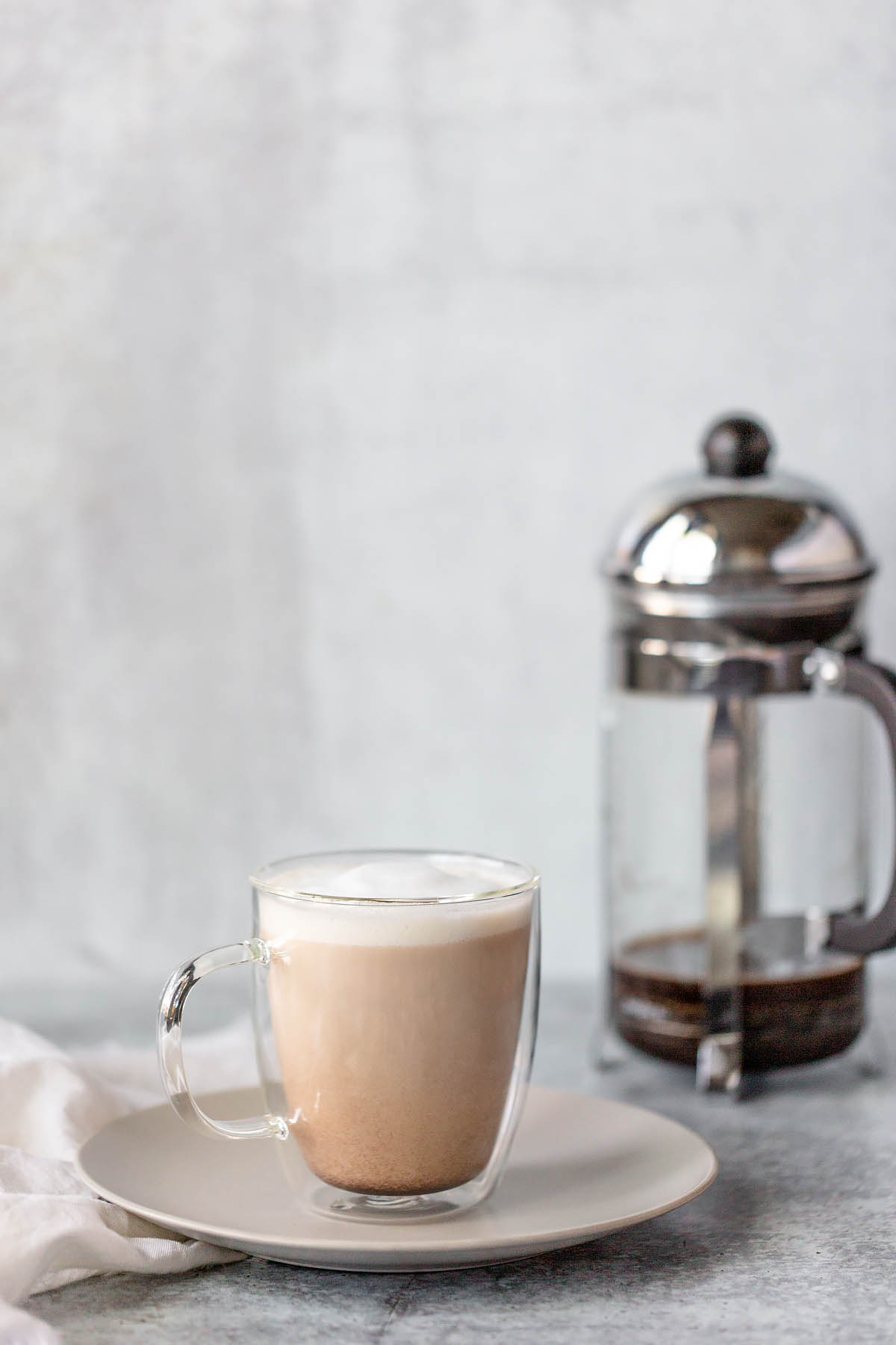 french press latte in a glass mug