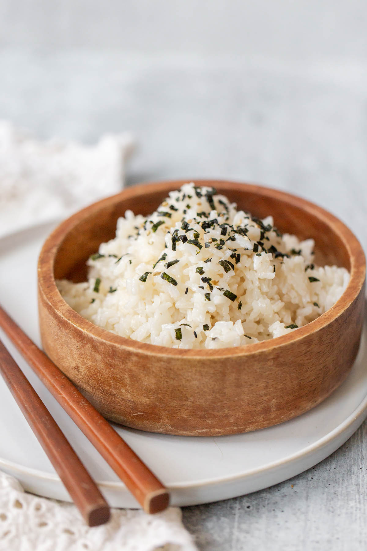 rice in a bowl with chopsticks