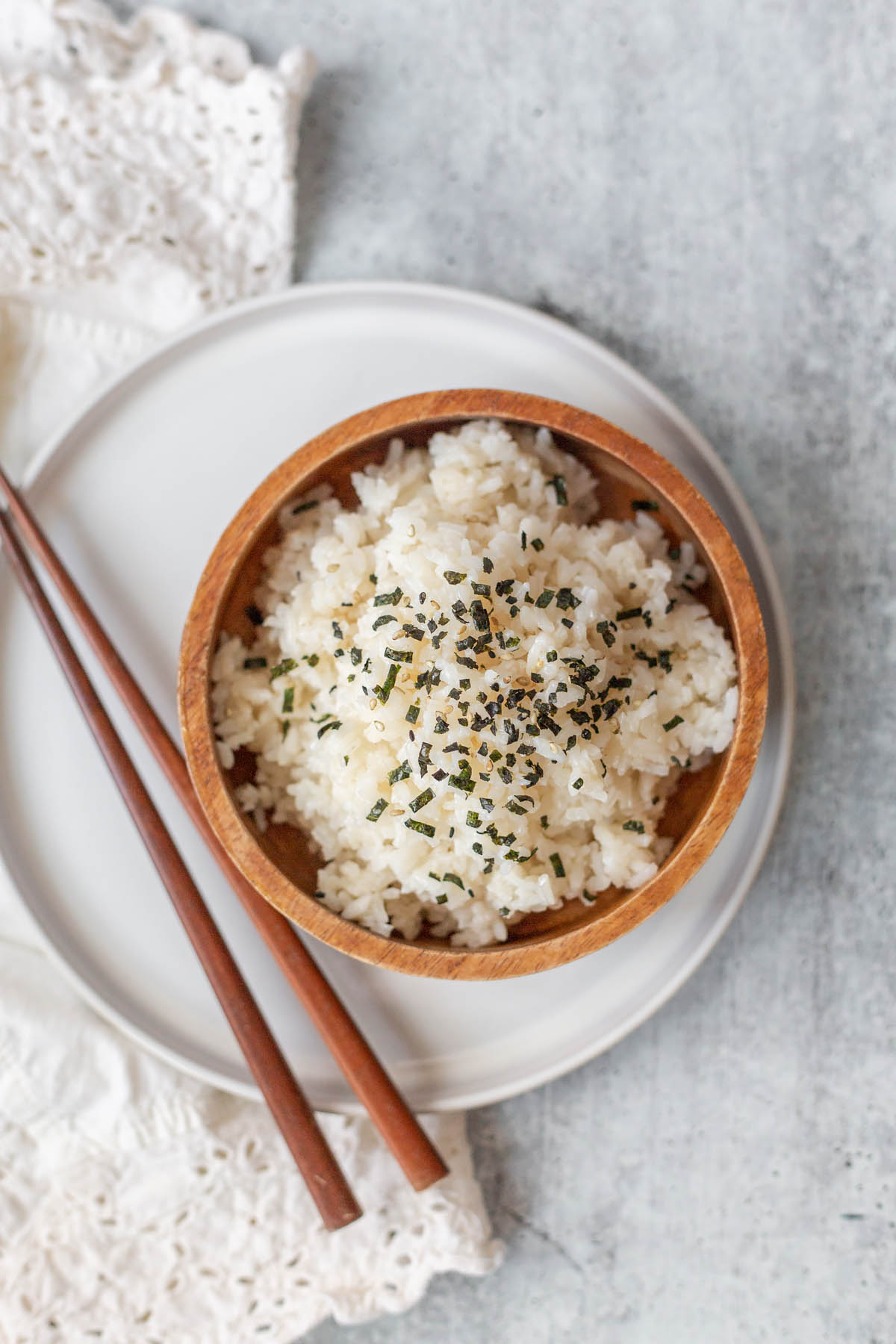 sesame rice in a bowl with chopsticks
