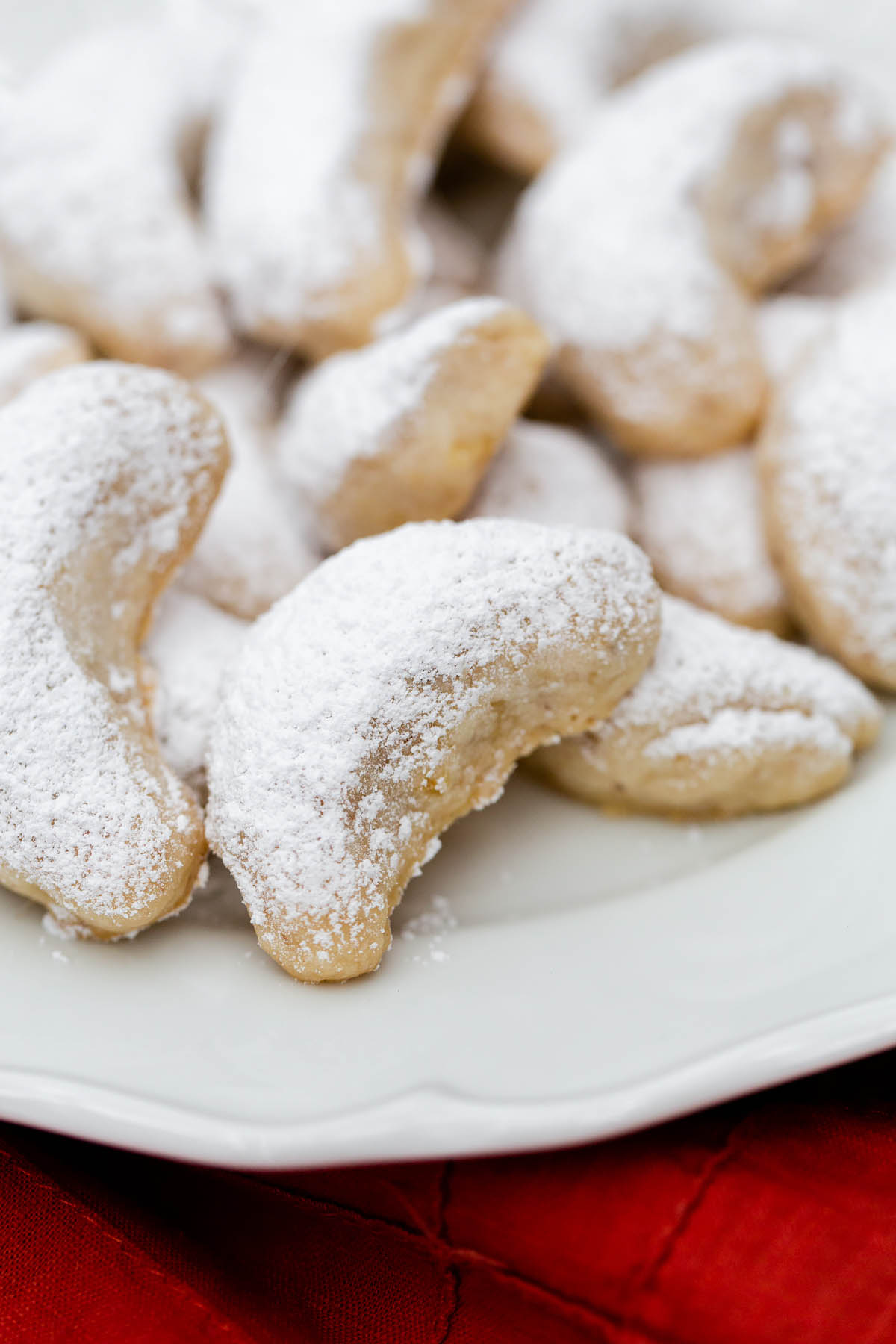 walnut crescent cookies on a plate