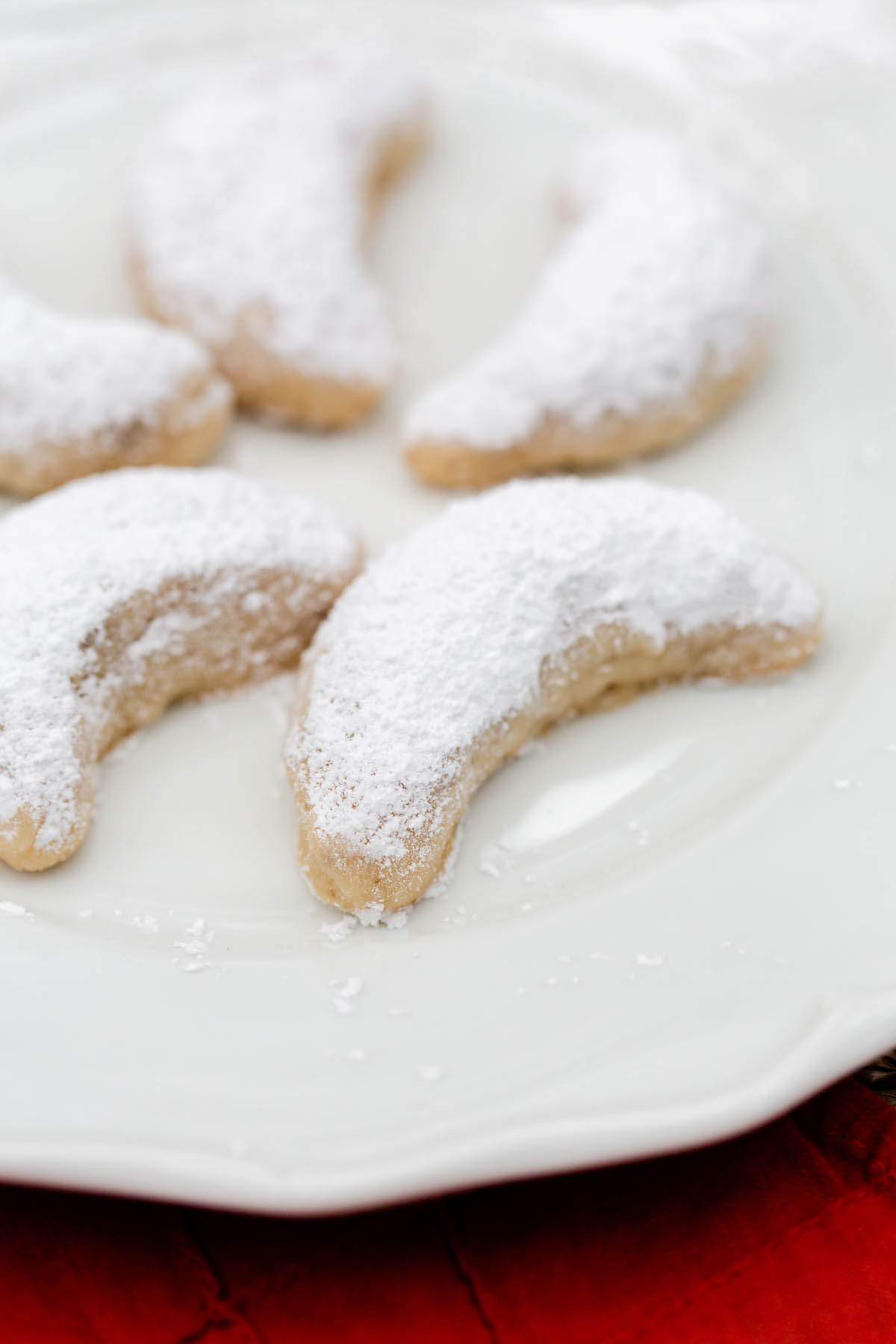 walnut crescent cookies dusted with powdered sugar