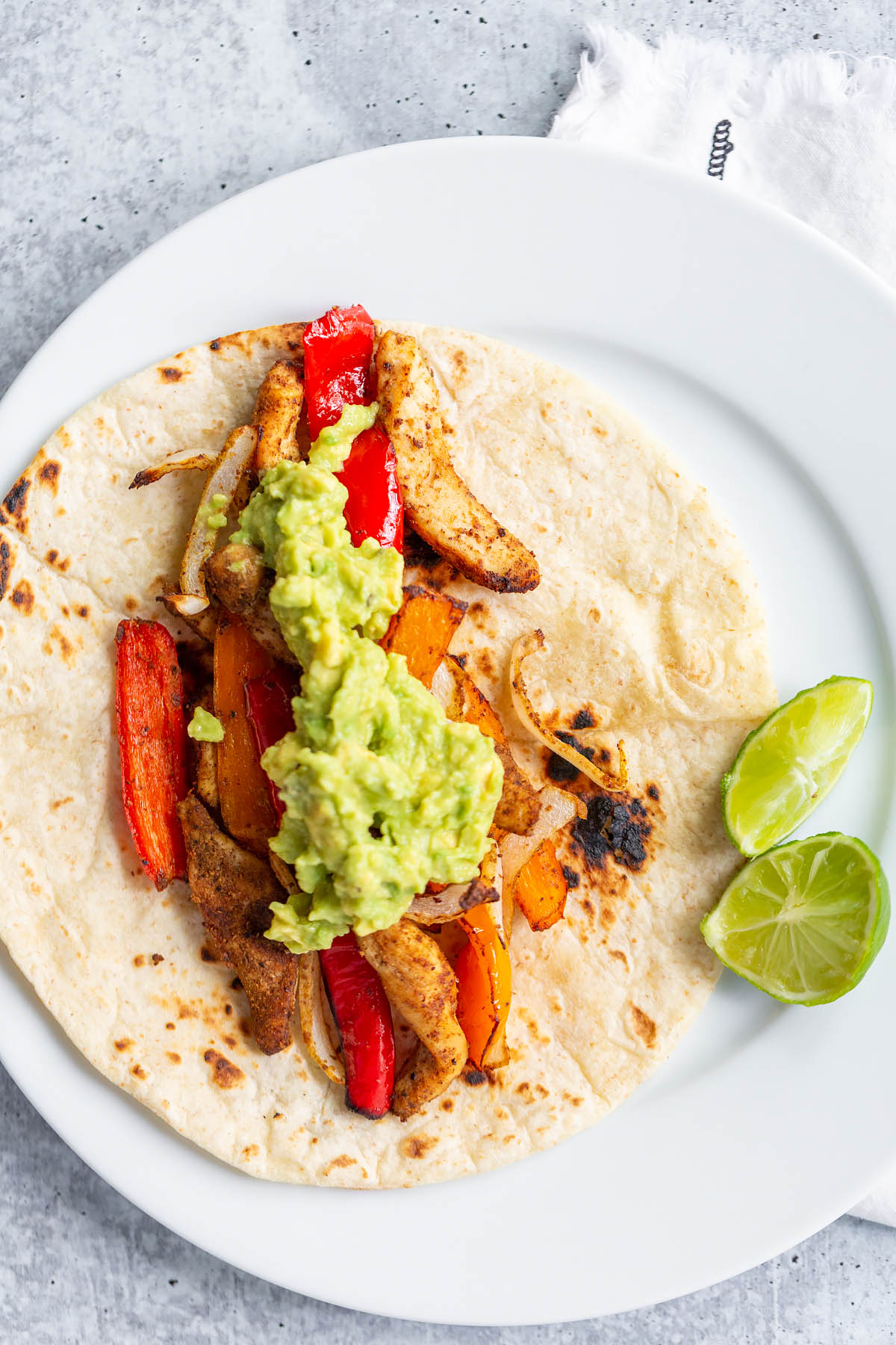 air fryer chicken fajitas on a tortilla