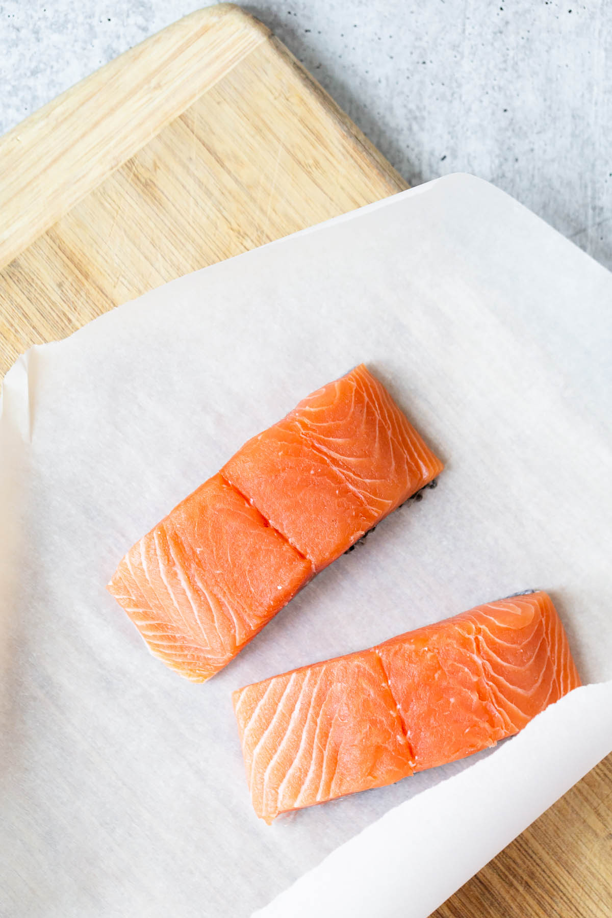 raw salmon on parchment paper