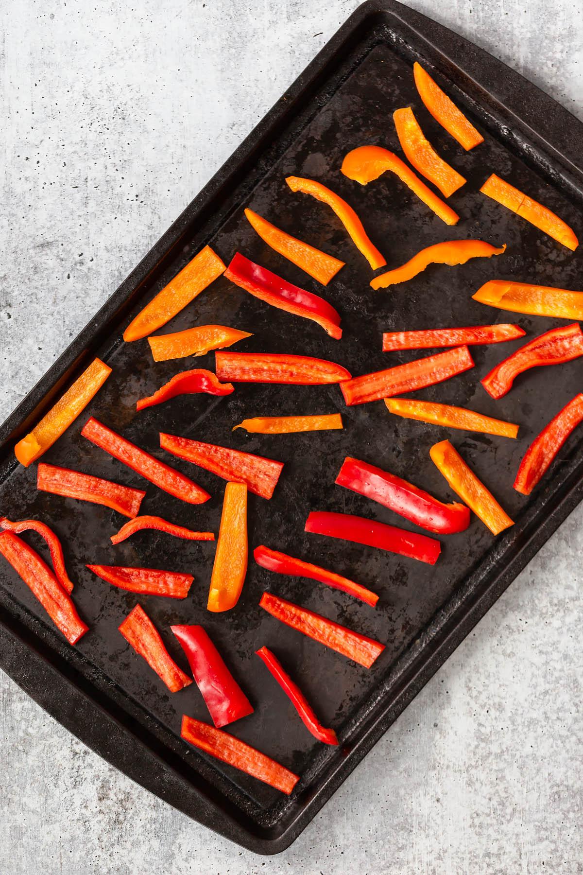 cut bell peppers on a sheet pan