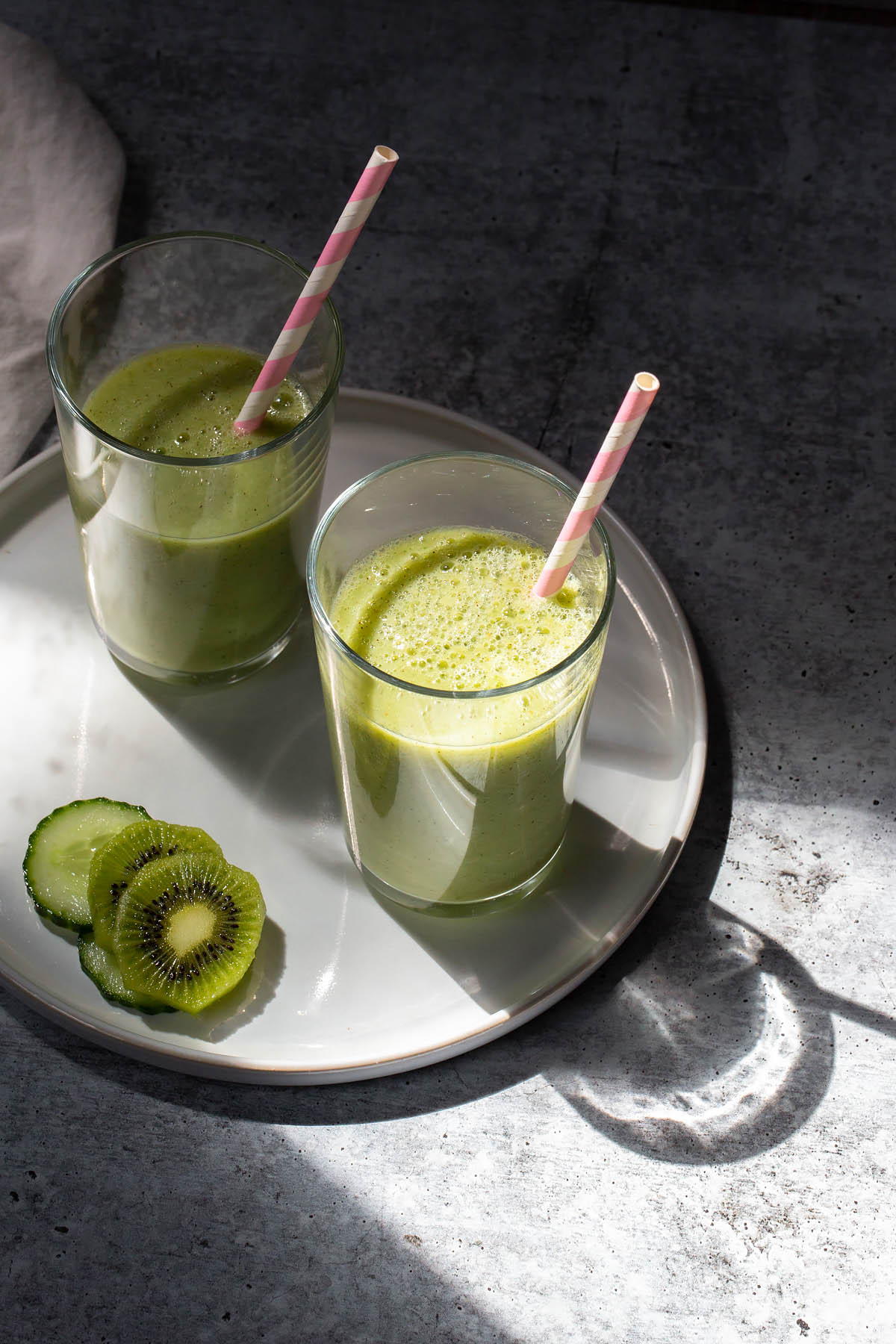 kiwi and cucumber smoothies with a straw