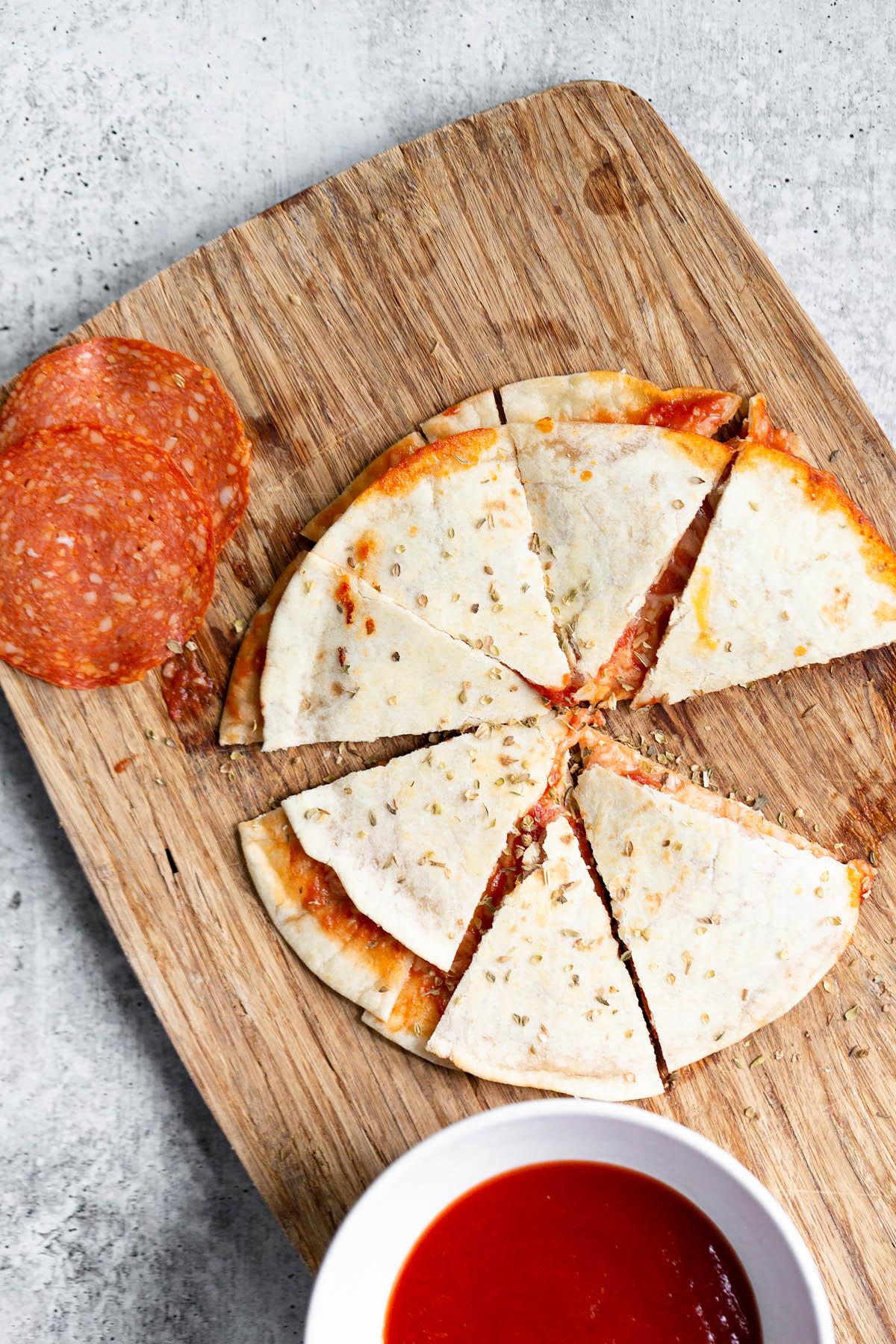 pizza quesadilla on a cutting board