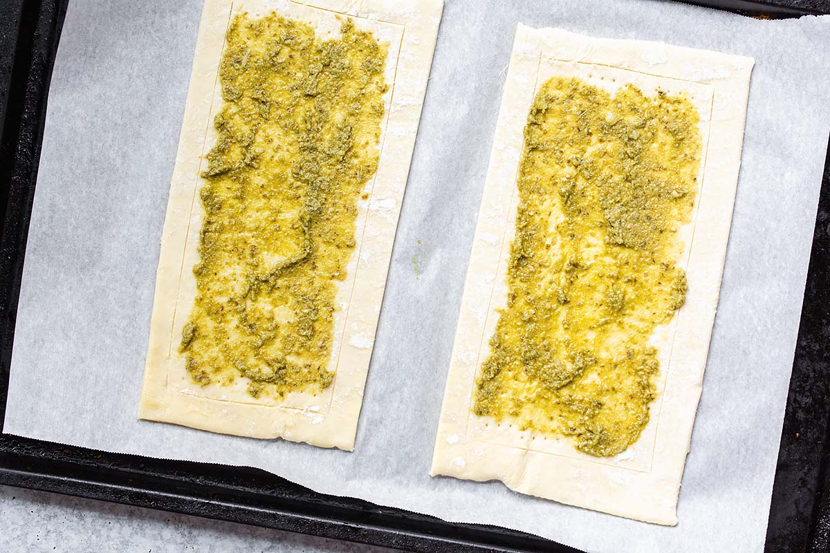 pesto on two sheets of puff pastry