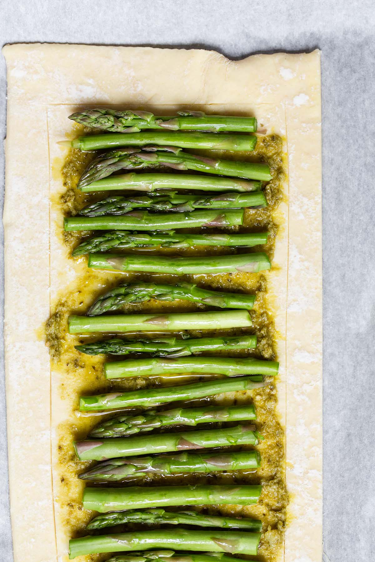asparagus up close on puff pastry
