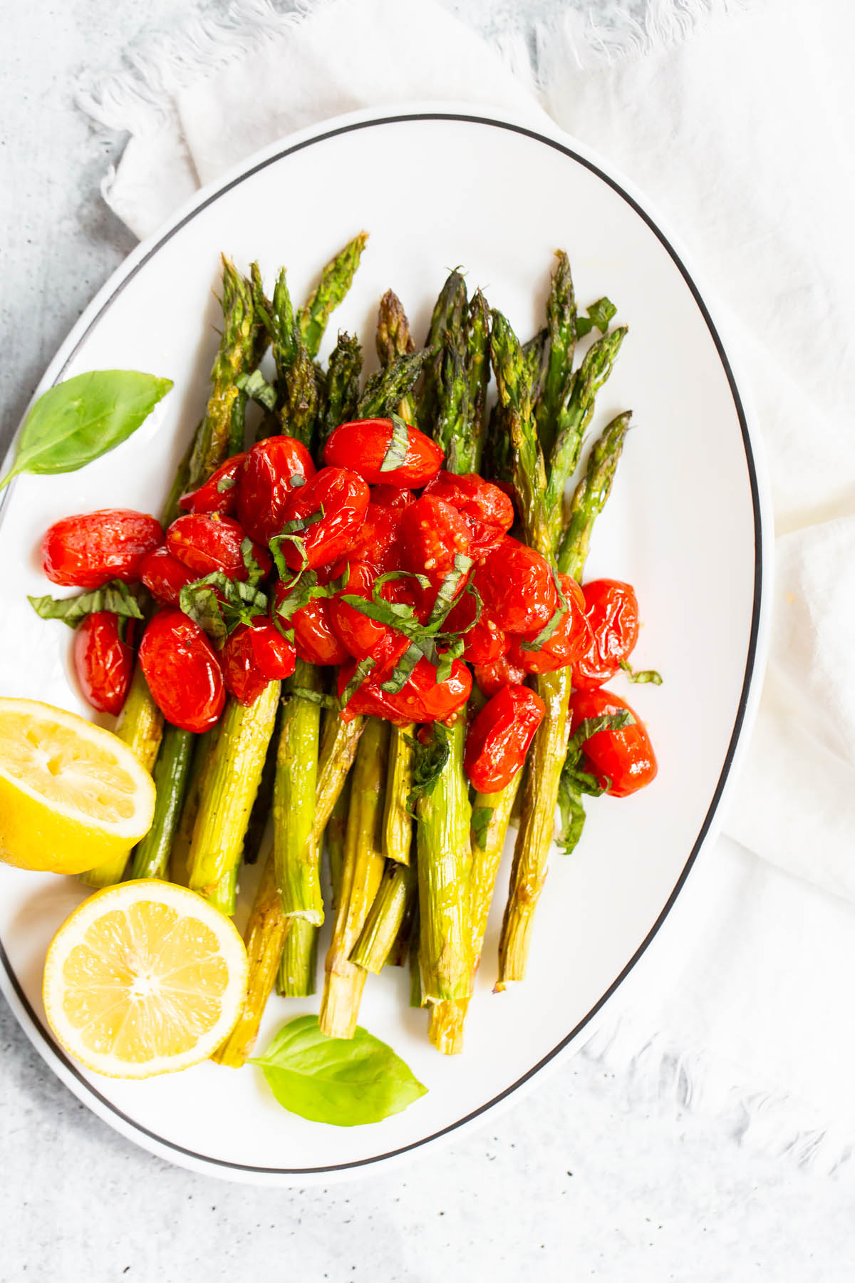 roasted asparagus with cherry tomatoes and lemon