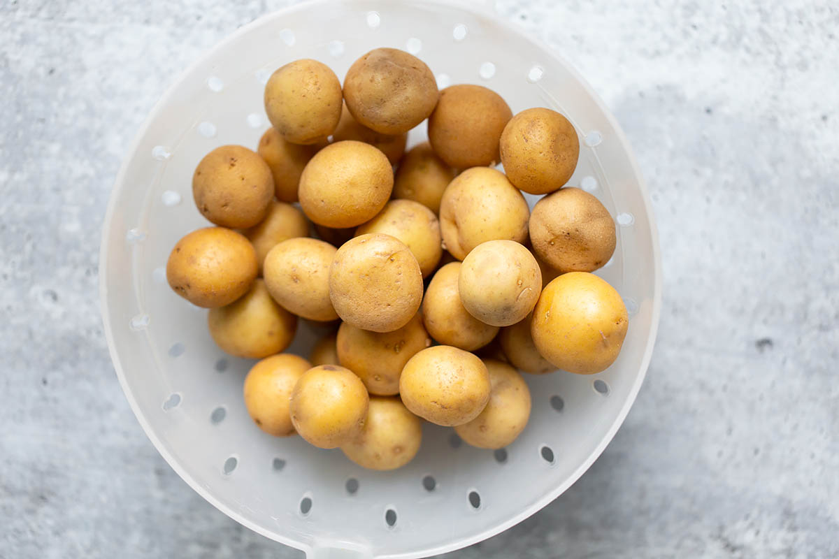 baby potatoes in a strainer