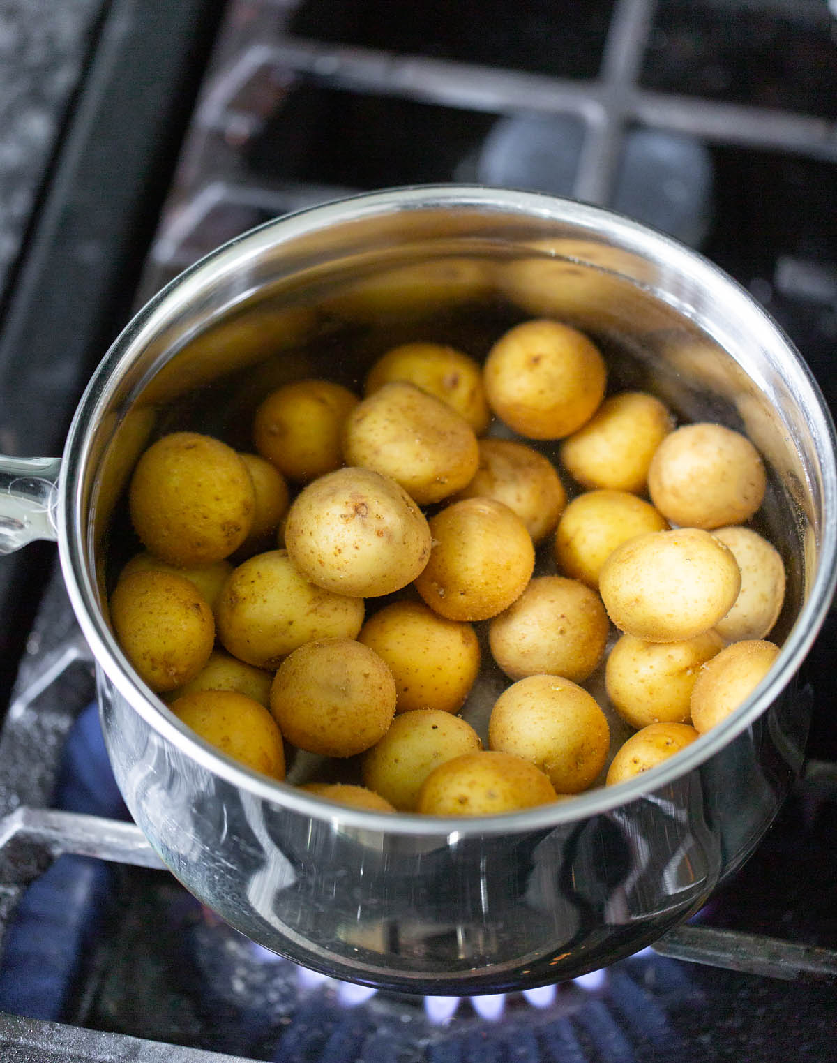 cooking baby potatoes in a pot