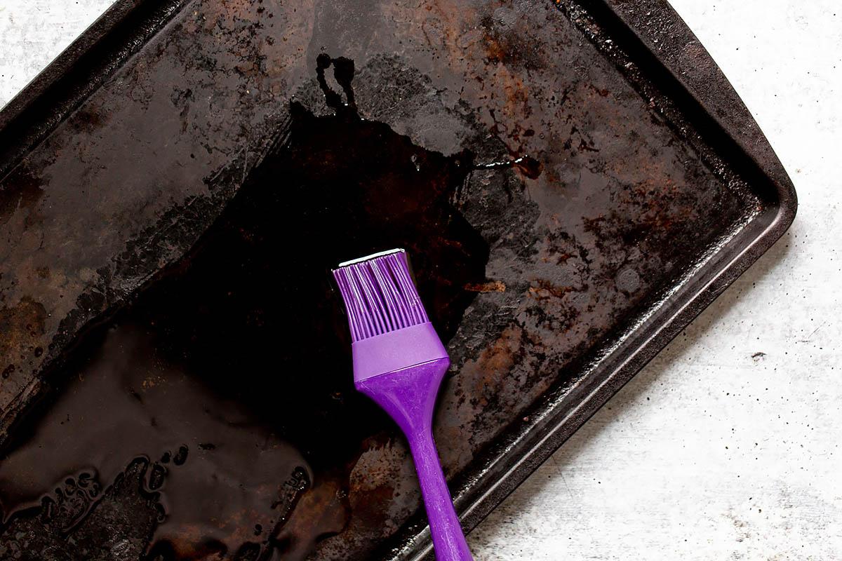 spreading oil onto a sheet pan