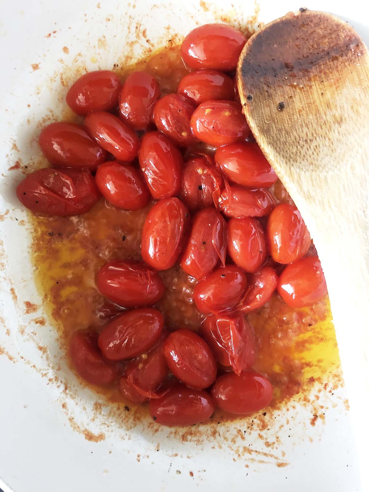 tomatoes cooking in a pan