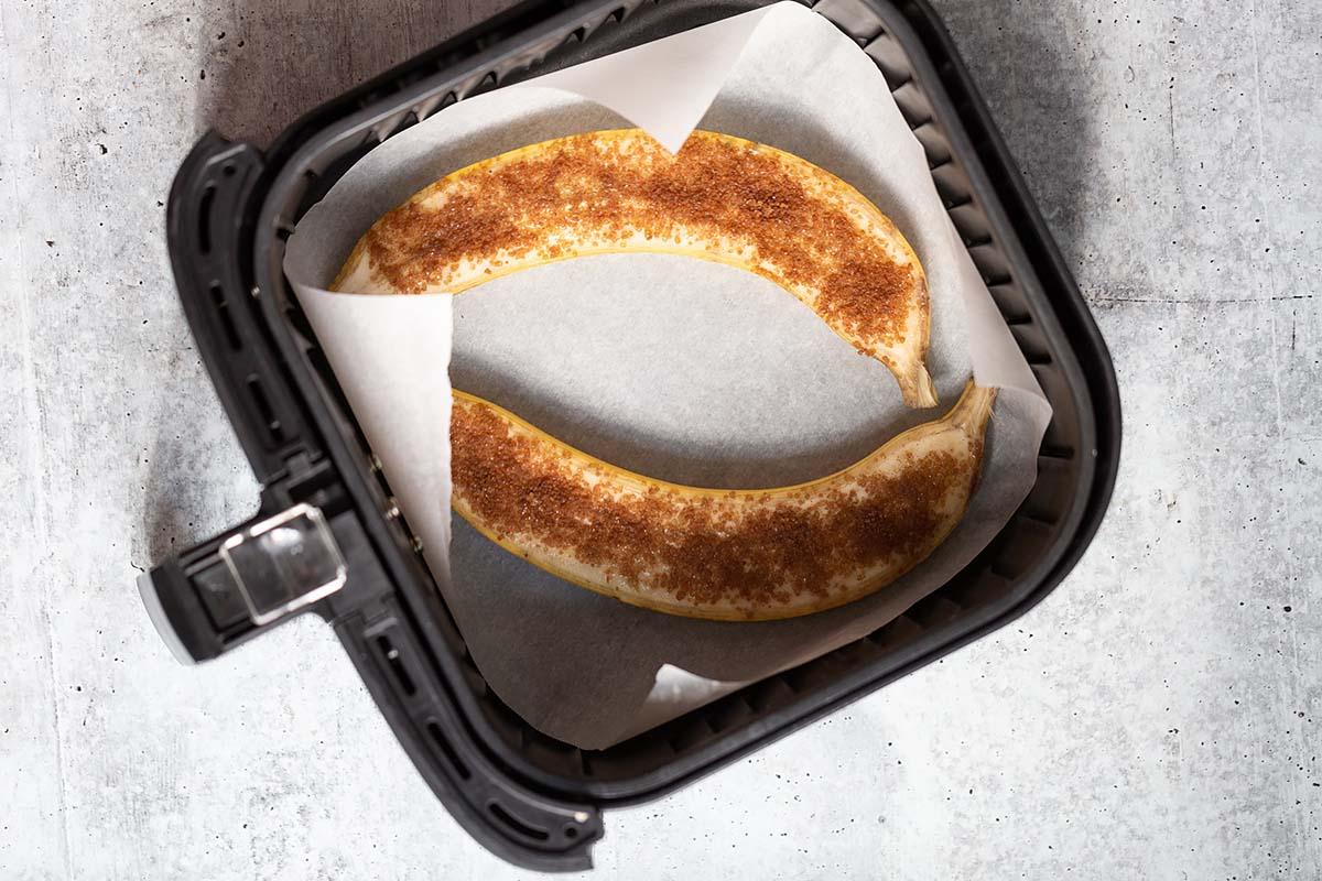 sliced banana in an air fryer basket