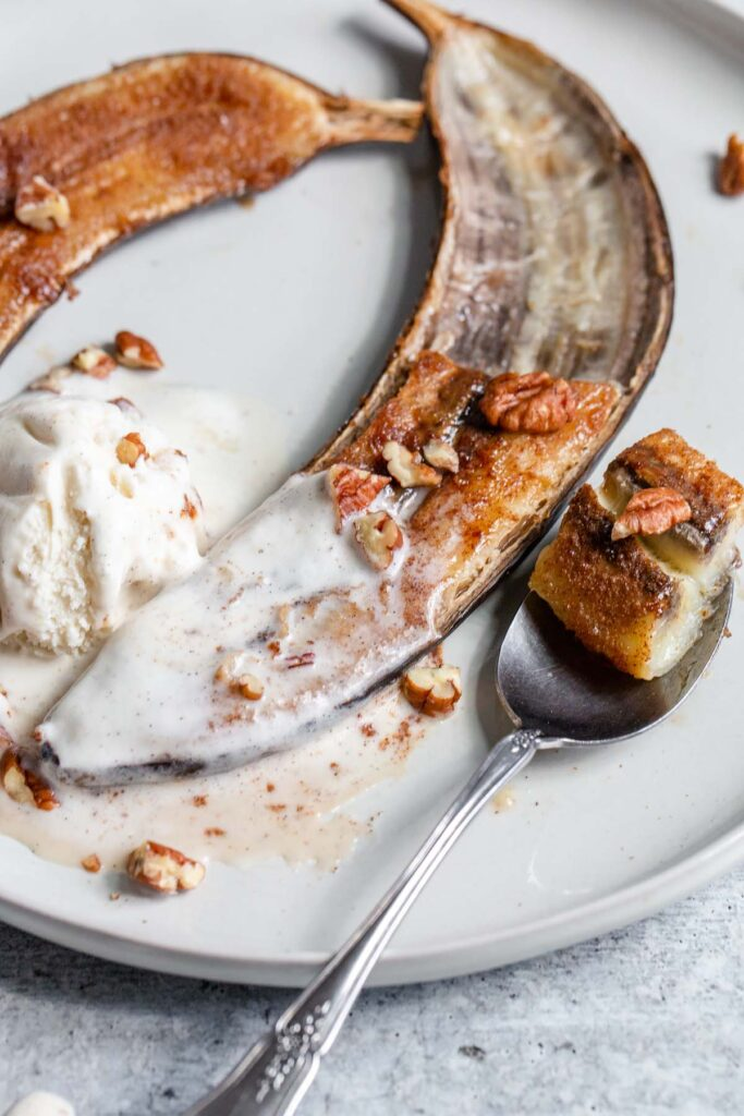caramelized banana with melted ice cream and a spoon