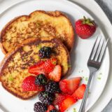 coconut lime french toast topped with blackberries and strawberries