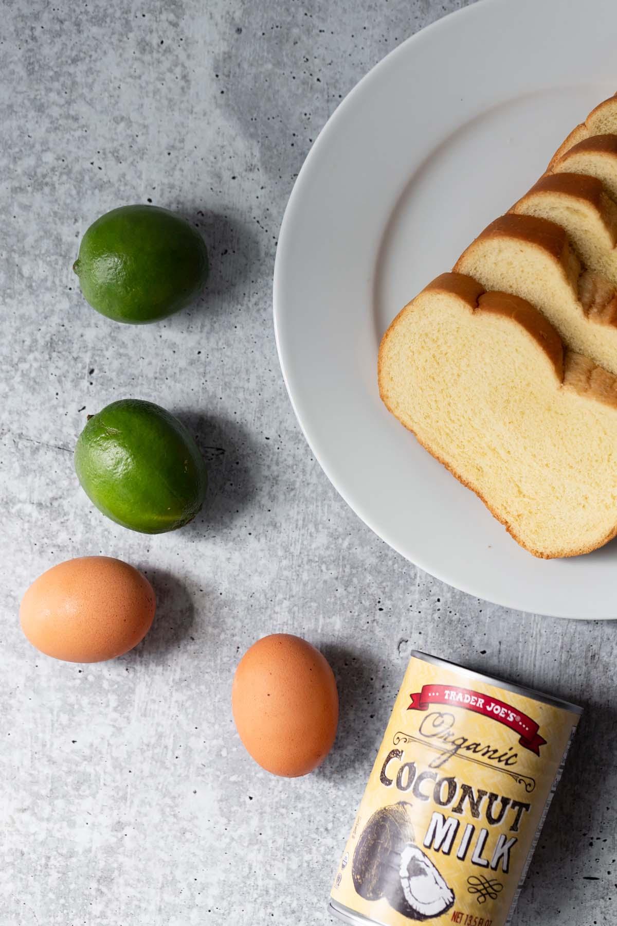 brioche bread, limes, eggs, and a can of coconut milk