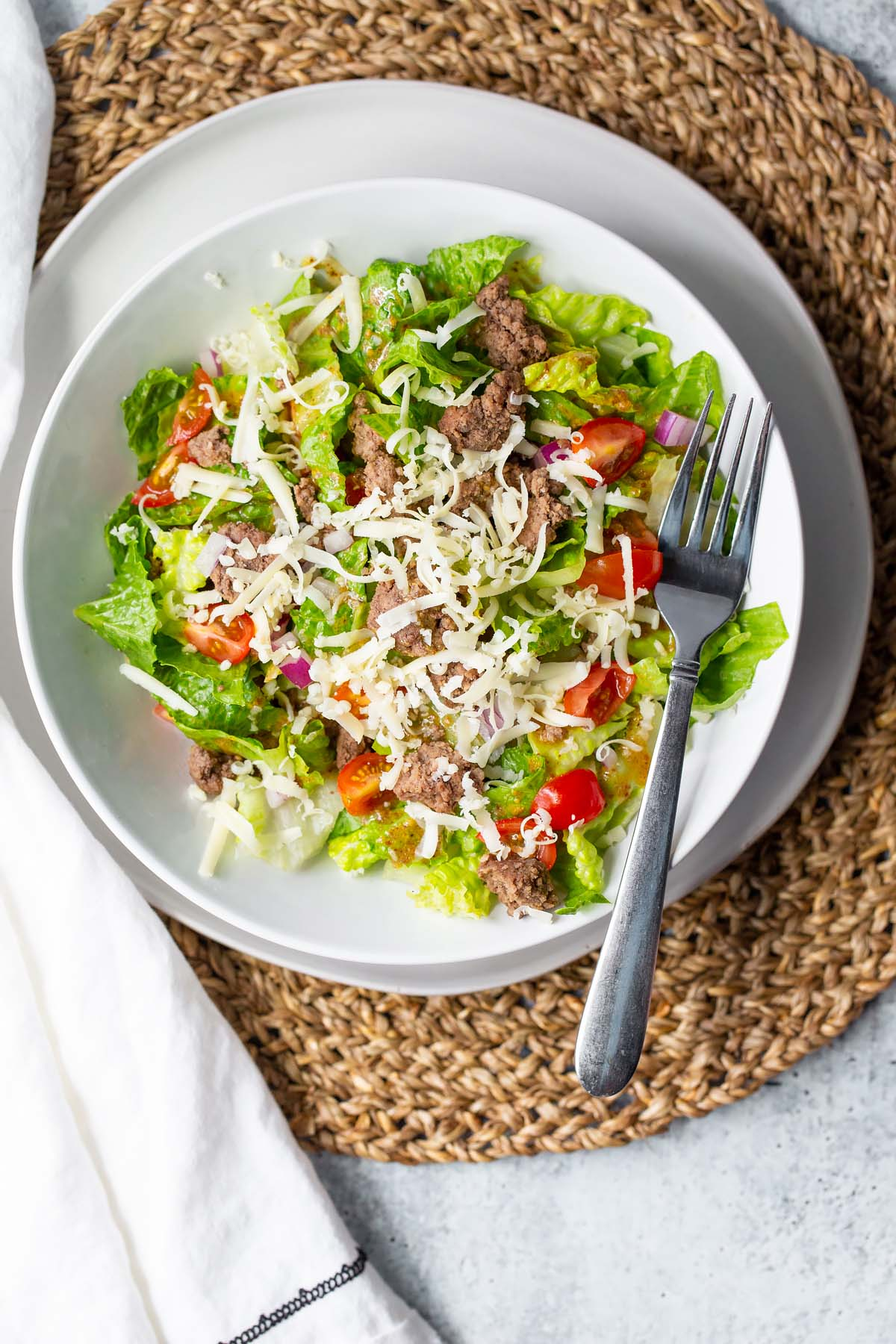 salad on a plate with a fork
