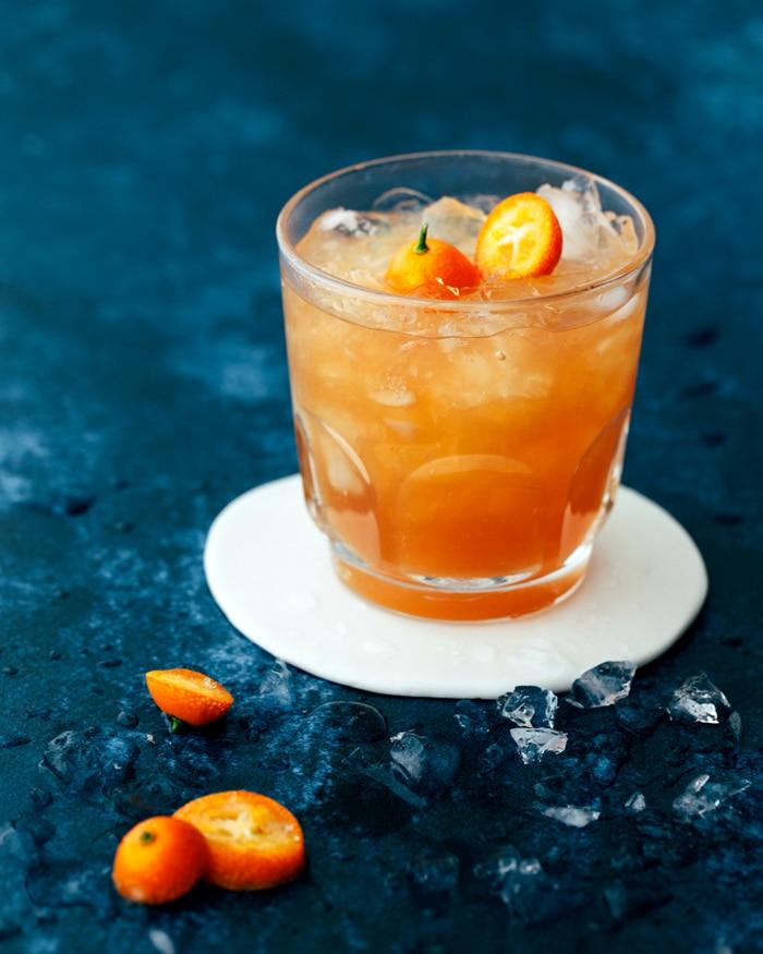mocktail with a kumquat garnish