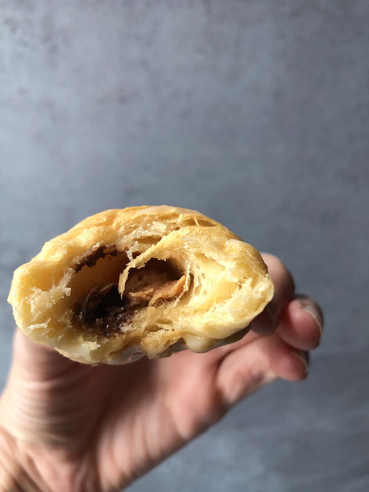 a half-eaten peanut butter chocolate croissant