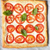 tomato and ricotta tart topped with fresh basil
