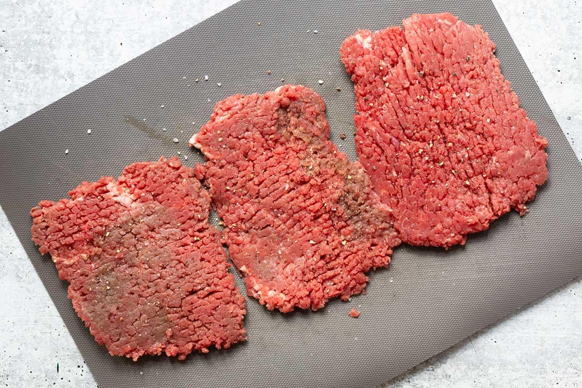 raw steak on a cutting board