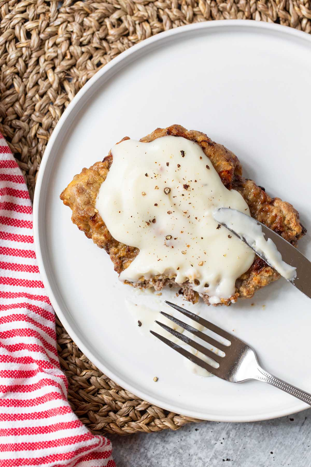 chicken fried steak with a piece cut out