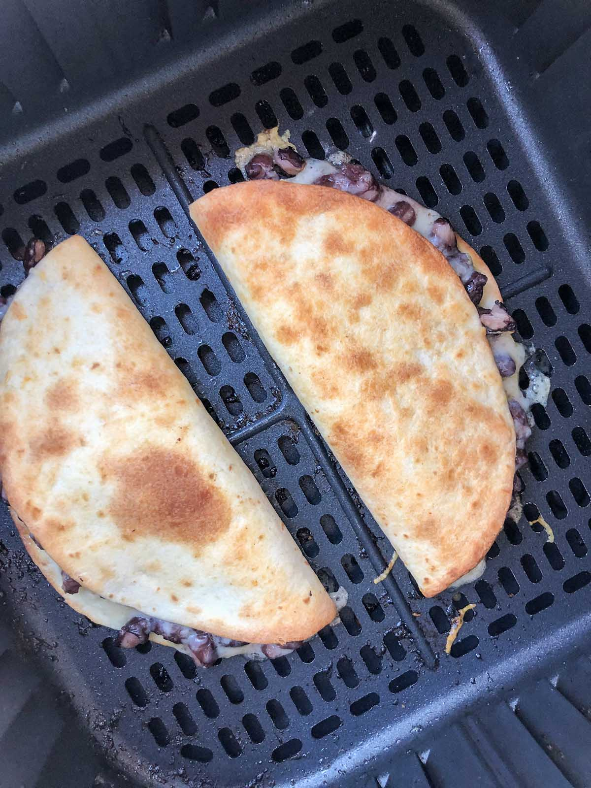 cooked quesadilla in air fryer basket
