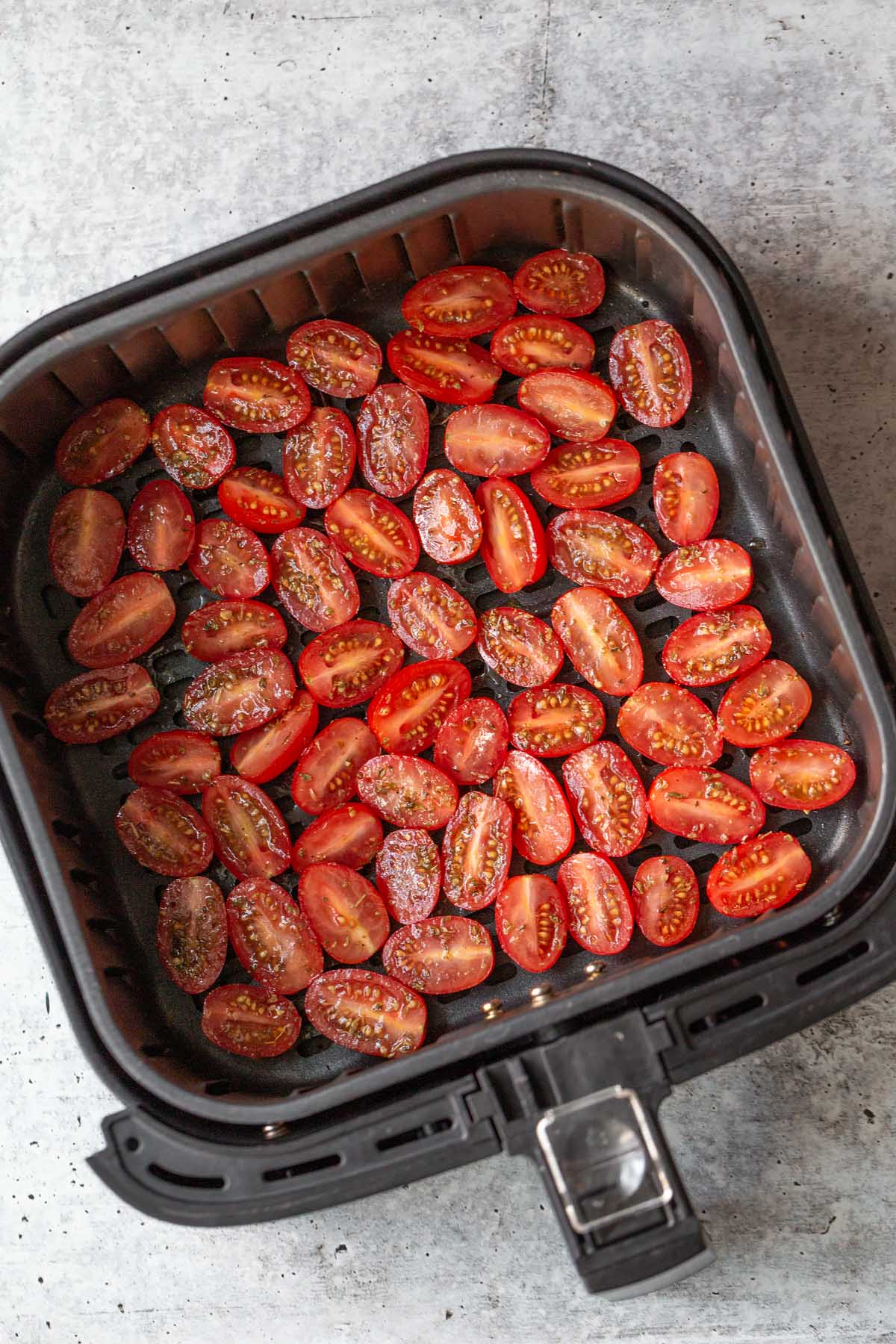 raw tomatoes in air fryer basket