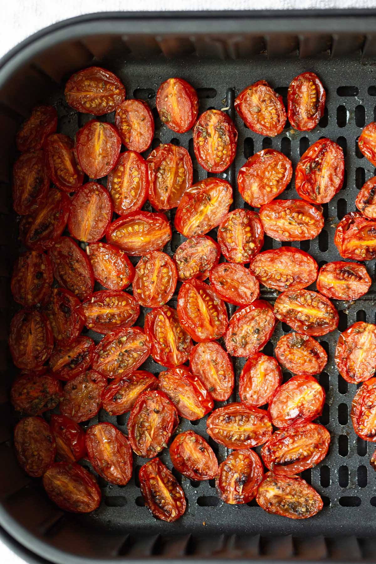 roasted tomatoes in air fryer basket