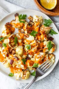 roasted cauliflower topped with harissa sauce